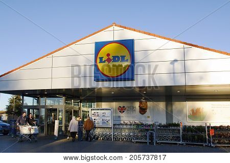 Llanelli, Wales, UK: November 07, 2016: . Lidl supermarket is a German global discount supermarket chain. shoppers are entering and leaving the store with supermarket trolley