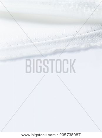 edge and seam of white fabric on white background white soft shadow room for text