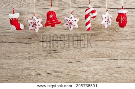Hanging Christmas and New Year decorations on a wooden background