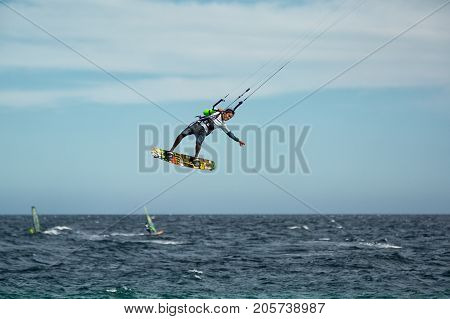 January 25 2014 Los Barriles Mexico: kiteboarder lifts off from water at the 'Lord of the Wind' kite surf competition