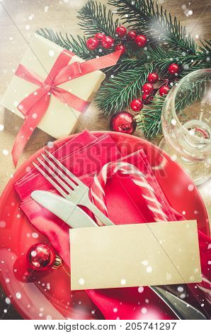 Festive table setting for Christmas holiday dinner with vintage flatware and decoration. Drawn Snow Falling Effect.