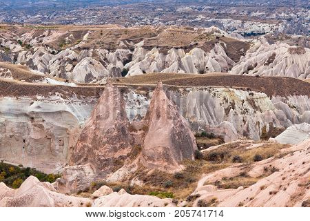 Unique geological formations in Red valley Cappadocia Turkey. Cappadocian Region with its valley canyon hills located between the volcanic mountains Erciyes Melendiz and Hasan.