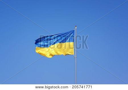 Ukrainian flag on blue sky backgroud. Ukraine flag