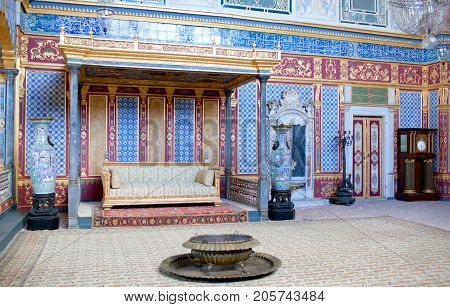 ISTANBUL, TURKEY - OCTOBER 31, 2015: Throne room inside Harem section of Topkapi Palace. Entertainments, weddings and exchange of Bayram felicitations took place in this hall.