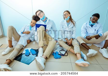 Interns Napping Is Hospital Corridor