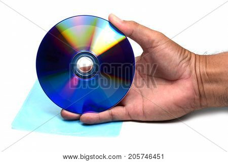 A Hand Holding Dvd Disc Over Plastic Bag On White Isolated Background