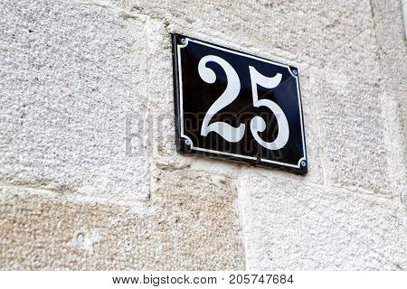 house number twenty-five 25 on the wall