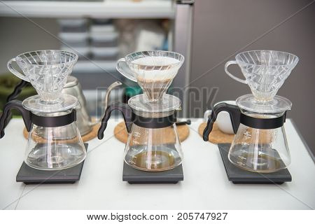 coffee drip set gadget for barista brewed arabica coffee from steaming filter on coffee table