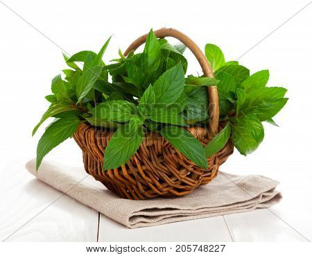 fresh mint in a basket isolated on a white background