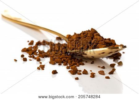 nstant coffee in the spoon on white background