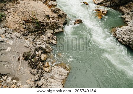 light blue mountain river with rapid flow. concept of floating downstream or fishing.