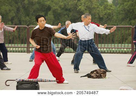 BEIJING, CHINA - MAY 01, 2009: Unidentified people practice tai chi chuan gymnastics in Beijing, China.