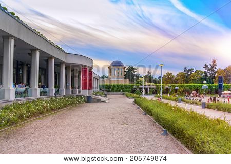 Wroclaw/Poland- August 17, 2017: view of park near Centennial Hall with ivy colonтade walkway, observing dome and restaurant, summer evening, sunset sky