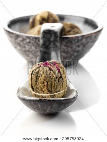Aromatic flower green chinese tea on white background