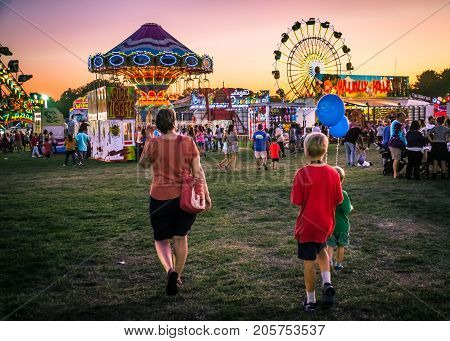 WEST WINDSOR NEW JERSEY - September 23 - Amusement park rides and plenty of people attended The 18th Annual Mercer County Italian American Festival on September 23 2017 in West Windsor NJ.