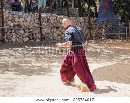 Jerusalem Israel September 23 2017 : Ukrainian Cossack demonstrates possession of two sabers at the festival