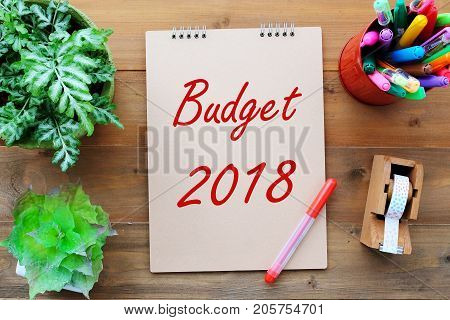 Budget 2018 on brown paper notebook background sucess in business concept annual report