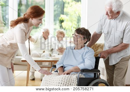 Nurse Saying Goodbye To Patient