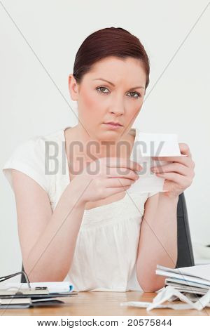 Young Attractive Red-haired Female Being Depressed By The Amount Of The Receipt