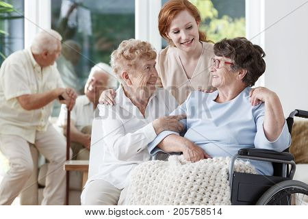 Nurse And Friend Supporting Lady