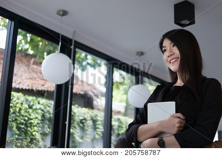 Businesswoman Smile At Workplace. Young Woman Working On Touchpad At Office. Freelancer Hold Digital