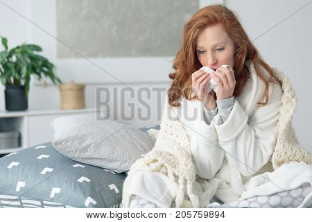 Miserable Woman Blowing Runny Nose