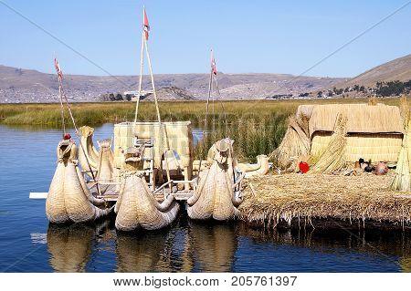 Uros floating islands on high altitiude lake Titicaca in Puno, Peru