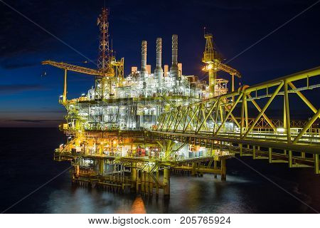Oil and gas central processing platform in sun set in the gulf of Thailand Oil and gas petroleum business.