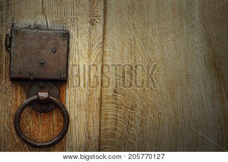 detail of old metallic hasp on oak wooden door