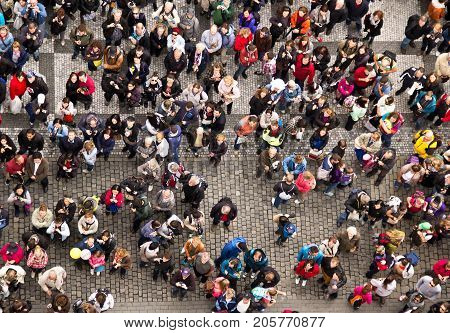 PRAGUE CZECH REPUBLICK - CIRCA JUNE 2013: The crowd of people on the square in the center of Praque. People make photos of sight view from above