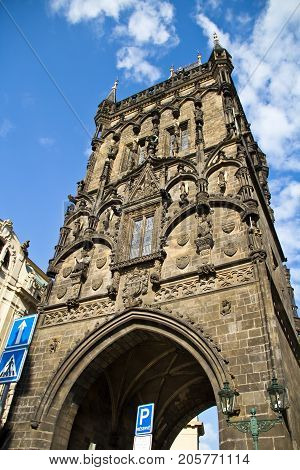 The Gothic Powder Tower (also known as Prasna Brana) in the Old Town of Prague Czech Republic. The part of the former Prague Old Town fortification built in 1475. Ancient building with the cloudy blue sky on the background.