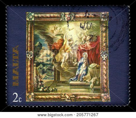 Malta - CIRCA 1977: A stamp printed in Malta shows annunciation of Our Lady, flemish tapestries, circa 1977