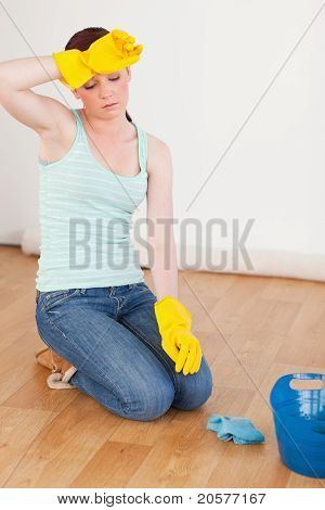 Attractive Red-haired Woman Having A Break While Cleaning The Floor