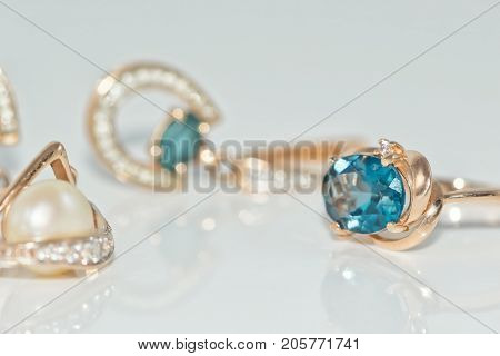 Gold Rings And Earrings Inlaid With Precious Stones