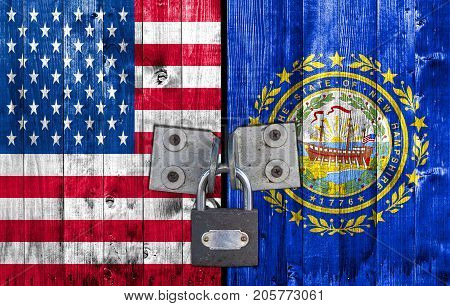 US and New Hampshire flag on door with padlock