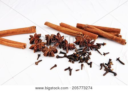 cinnamon staranise and cloves. winter spices on white background