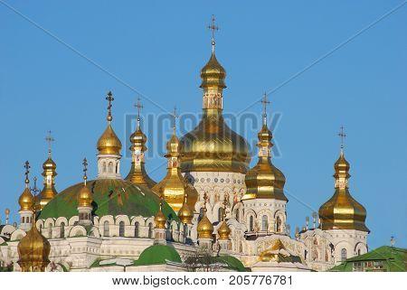 Orthodox church dome.Lavra Kiev, Ukraine, against the blue sky, golden domes