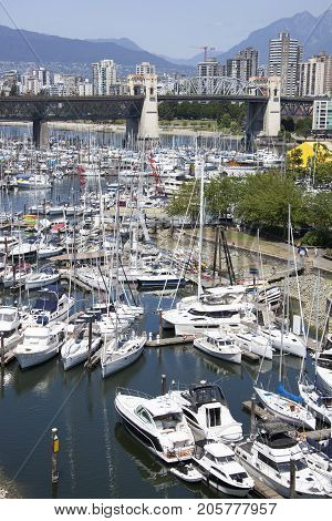 The view of Vancouver city marina in False Creek and Burrard Street Bridge in a background (British Columbia).