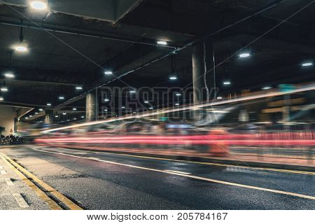 a double-decker bus driving out of underground parking lot,hong kong,china.