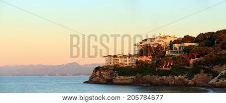 Coast of the Mediterranean Sea at sunrise. Costa Dorada spanish resort in the morning. Beautiful resort landscape.