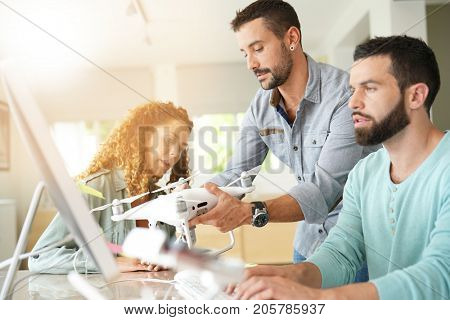 Startup people in office working on drone technology