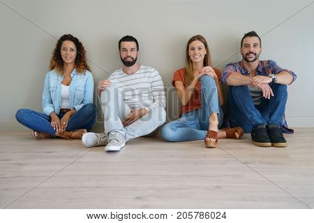 group of friends sitting on floor