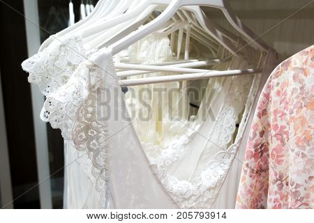 A white nightgowns hang in the store