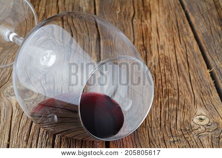 Wine Glass With Drop Of Red Wine Lay On Table