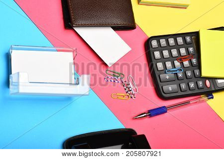 Mans Leather Wallet And Stationery On Colourful Background