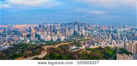 Panorama of Seoul downtown cityscape and Namsan Seoul Tower on sunset from Inwang mountain. Seoul, South Korea. poster