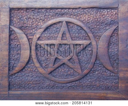 Goddess symbol with pentacle and adjacent crescent moons