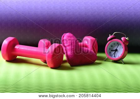 Heart Decoration Near Barbells On Yoga Mat
