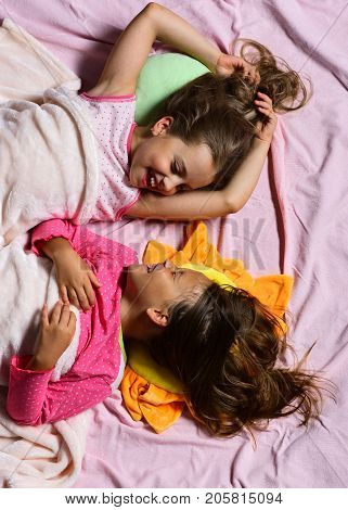 Kids With Cheerful Faces Smile At Each Other In Bed