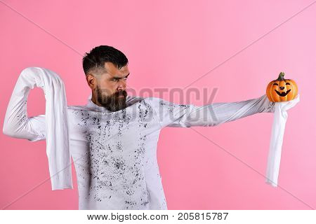 Guy With Beard Holds Orange Pumpkin With Smile In Hand